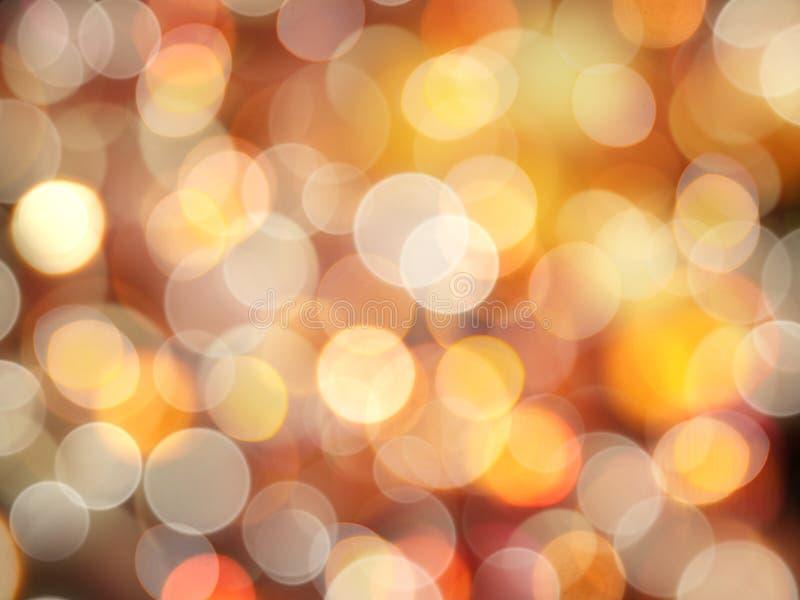 金黄发光的明亮的桔子和白色圆的被弄脏的光抽象庆祝背景 图库摄影