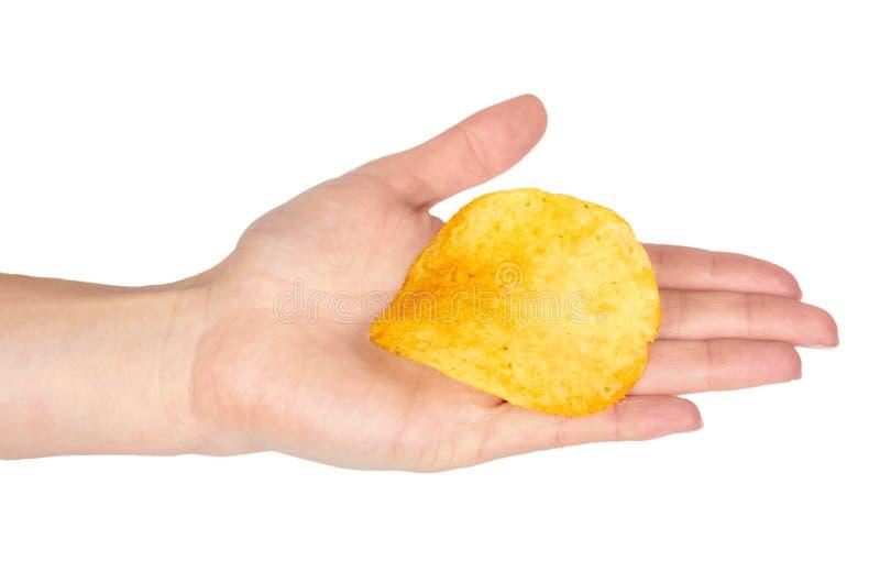 金黄土豆片用手,隔绝在白色背景 库存图片