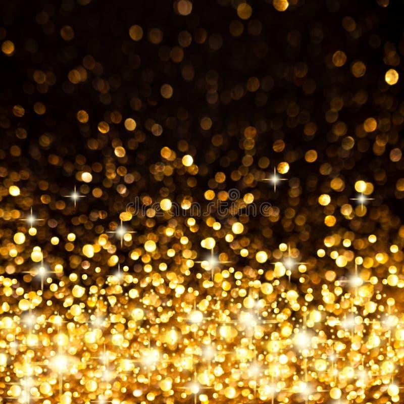 金黄圣诞灯背景 免版税库存图片