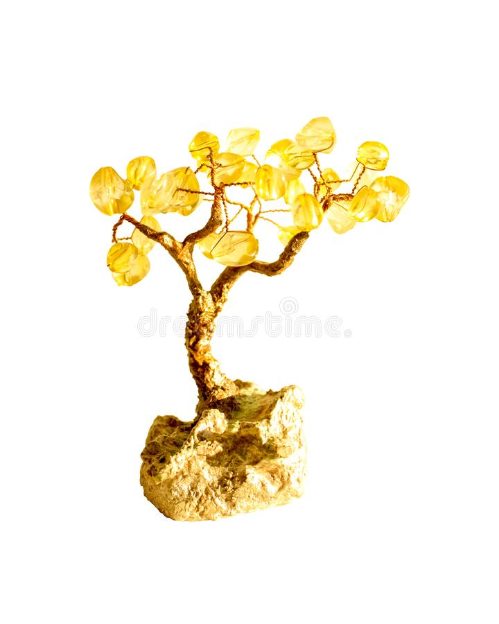 金黄盆景树,从小珠的纪念品 查出在白色 免版税库存照片