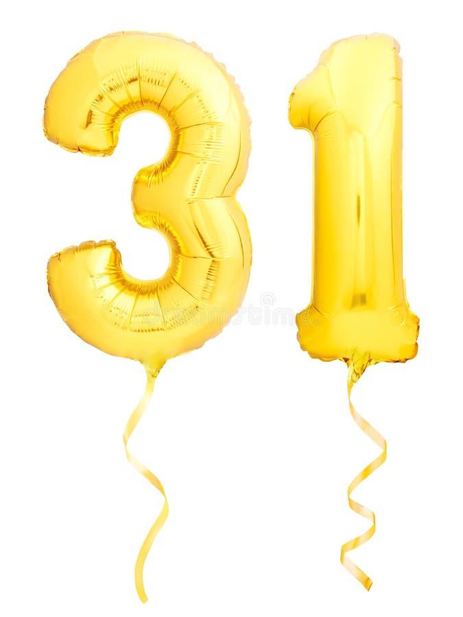 金黄第31三十一个做了有丝带的可膨胀的气球在白色 库存图片