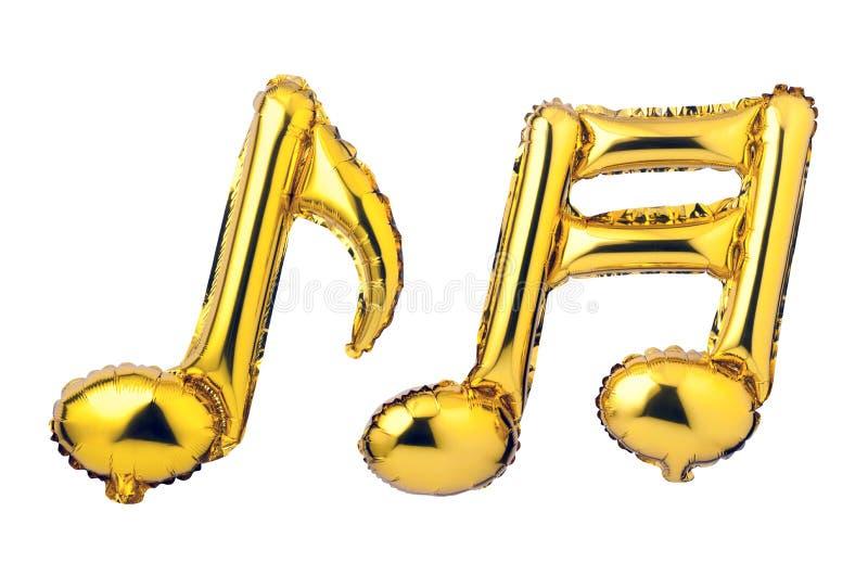 金黄箔气球音符  免版税库存照片