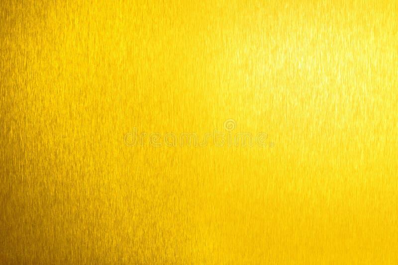 金黄金属发光的空的表面,黄色光亮的金属背景,金板料背景关闭,装饰闪耀的纹理 免版税库存照片
