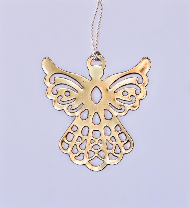 金黄金属天使魅力 圣诞节装饰装饰新家庭想法 库存图片