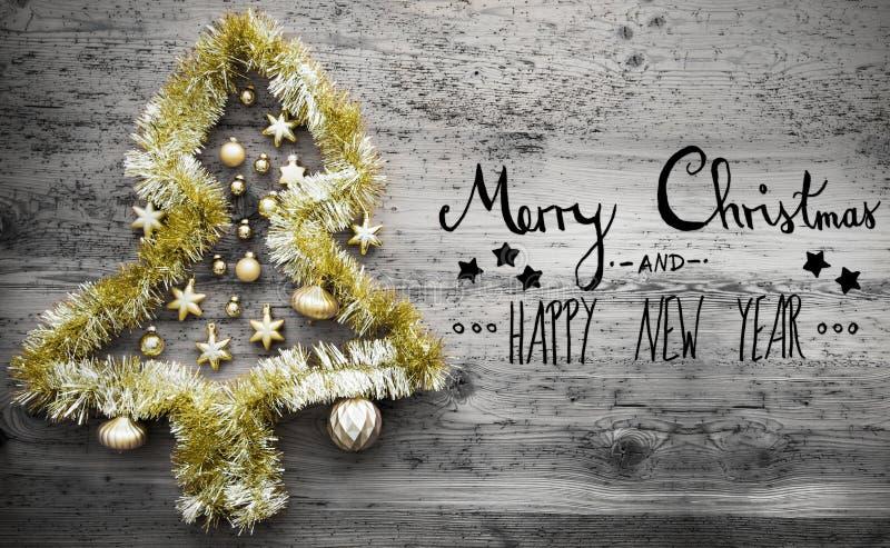 金黄闪亮金属片树、书法、圣诞快乐和新年快乐 免版税库存照片