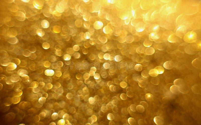 金黄闪烁圣诞节抽象bokeh背景 被弄脏的闪闪发光背景 库存照片
