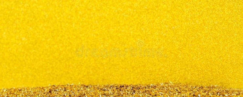 金黄闪烁的发光的织地不很细背景 库存照片