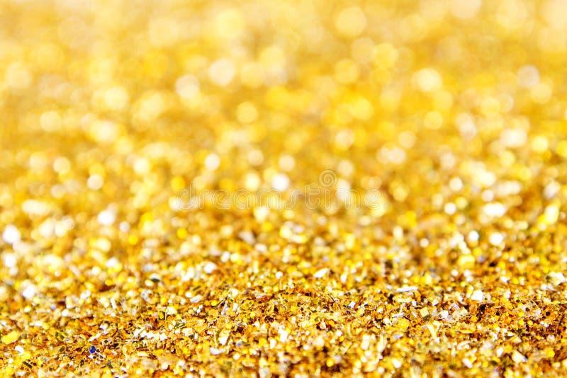 金黄闪烁的发光的织地不很细背景 图库摄影