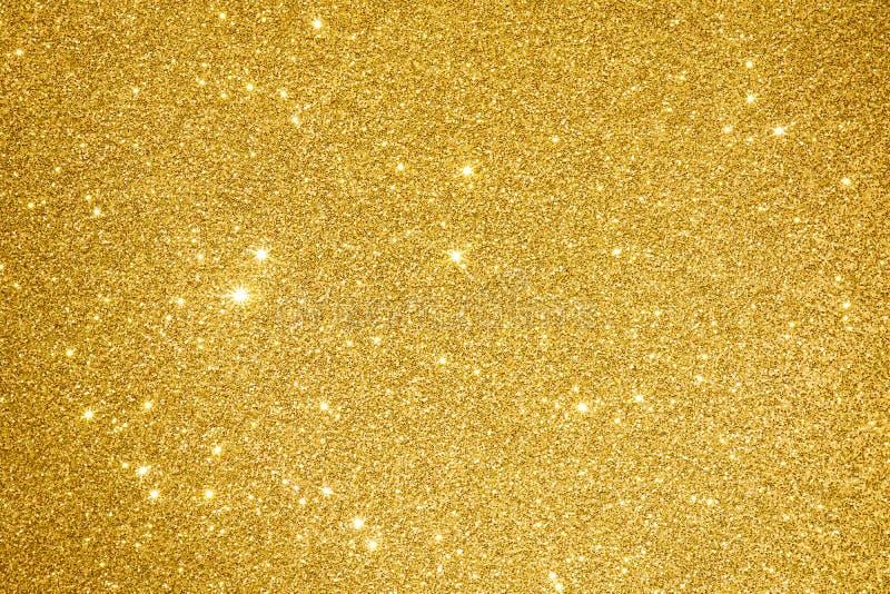 金黄闪烁背景纹理摘要光设计自然m 免版税库存照片