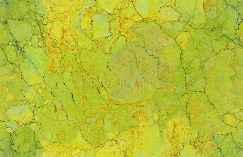 金黄黄绿色自然无缝的大理石石纹理样式背景 概略的自然石无缝的大理石纹理表面 库存照片
