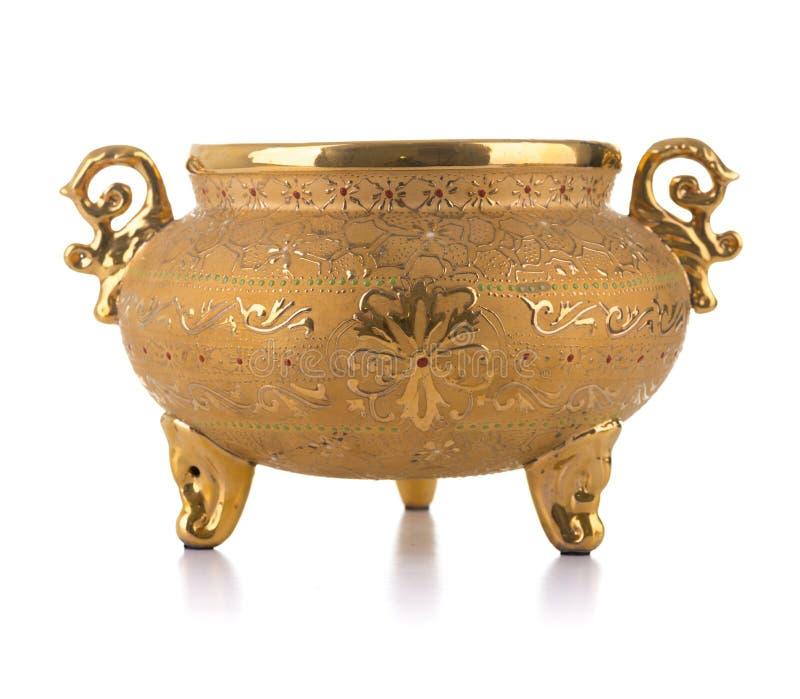 金黄古色古香的罐 库存图片
