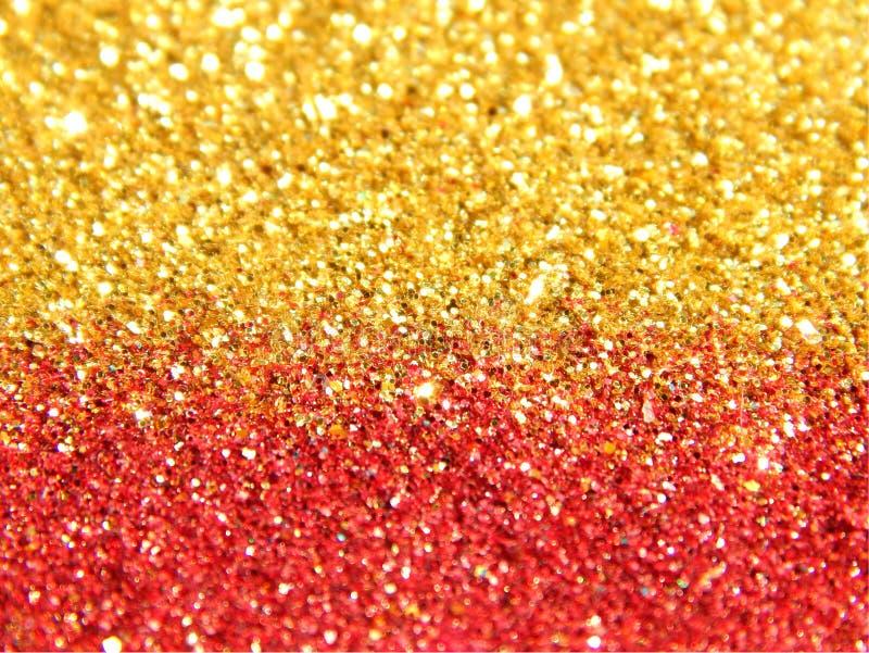 金黄和红色闪烁闪闪发光模糊的背景  库存图片