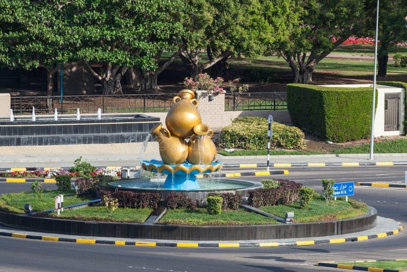 金黄咖啡壶纪念碑在阿曼 免版税库存图片