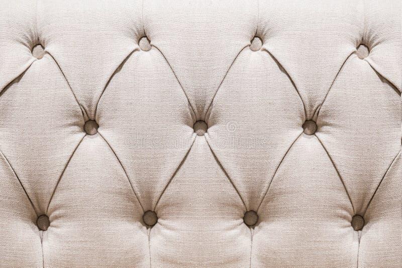 金黄天鹅绒capitone纺织品背景,方格减速火箭的样式 免版税库存照片