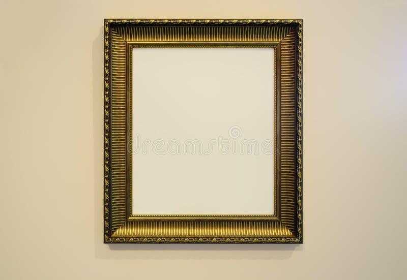 金黄画框和墙壁纹理照片 免版税库存图片
