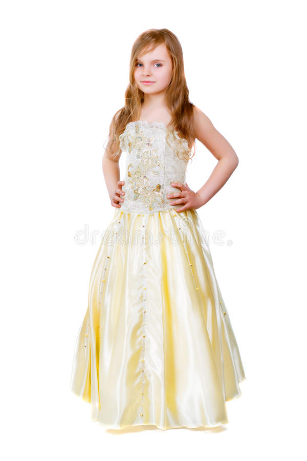 金黄礼服的小女孩 免版税库存照片