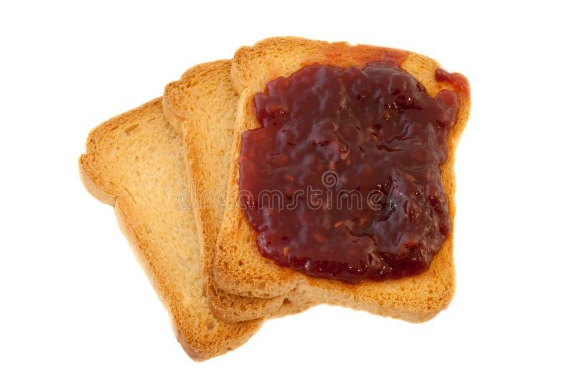 金黄面包干和果酱 免版税库存照片