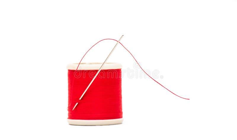 针和螺纹在红色 库存照片
