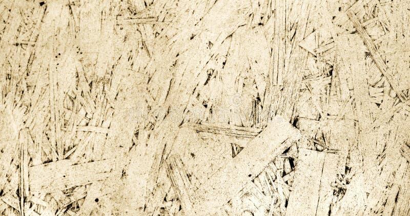 针对的子线板, OSB,从被按的木盘区的轻的背景被绘的纹理  免版税库存图片