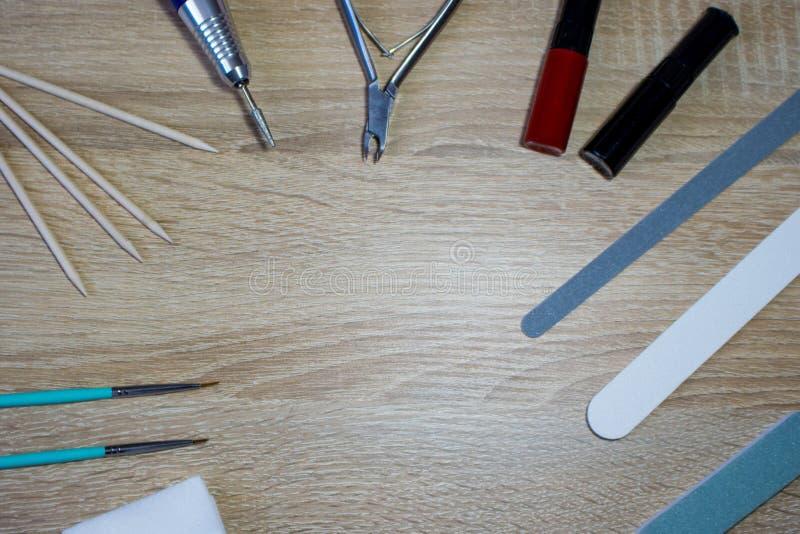 钉子艺术辅助部件,与修指甲的静物画 库存照片