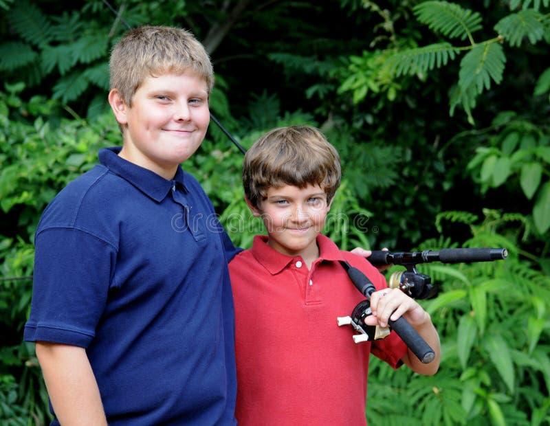 钓鱼去的男孩 库存照片