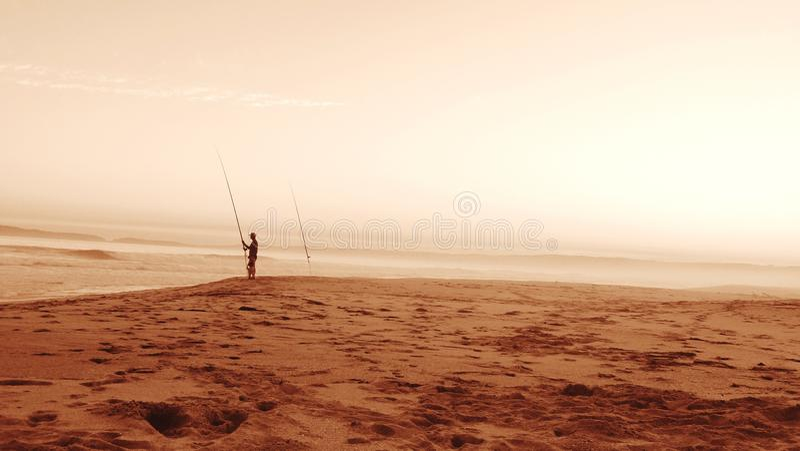 钓鱼在黄昏 库存图片