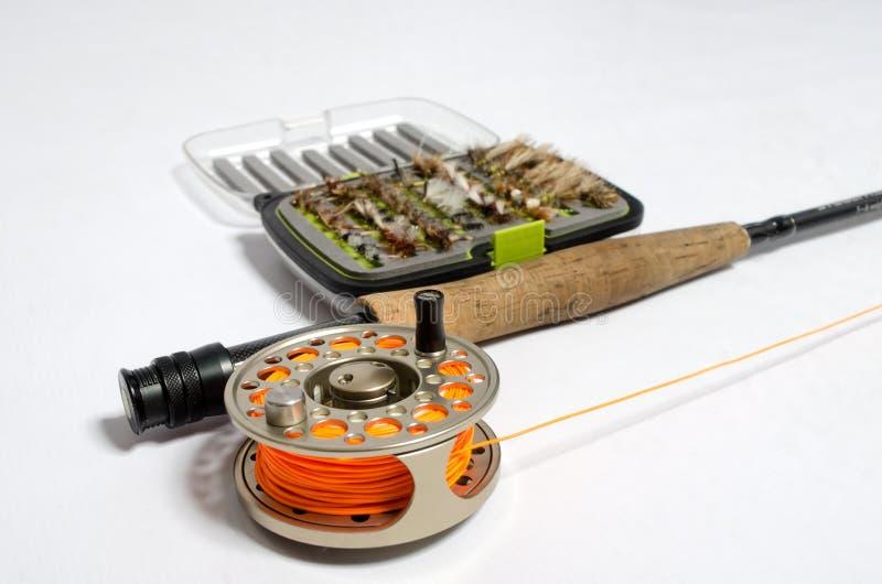 钓鱼竿和卷轴与飞行 库存图片