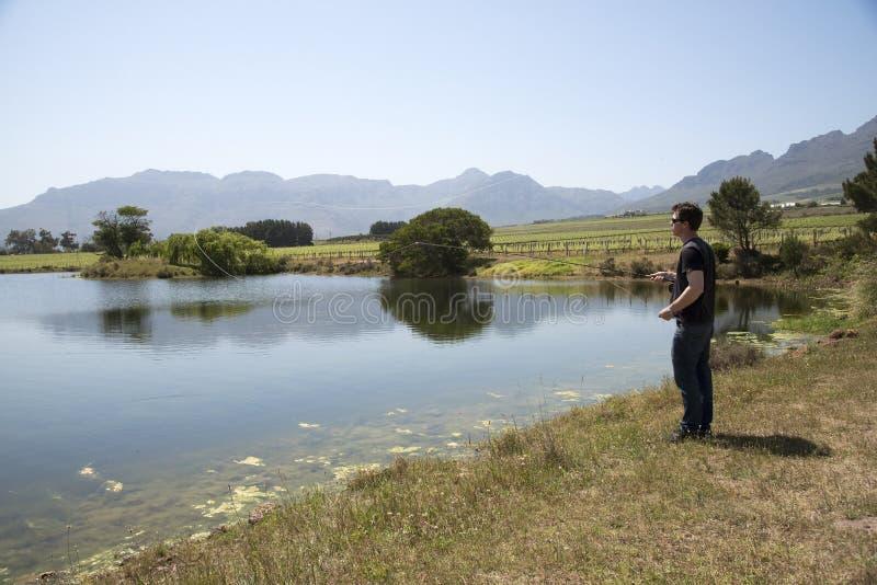 钓鱼者用假蝇钓鱼南非 库存照片