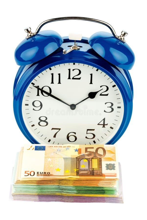 钞票时钟概念货币时间 库存照片
