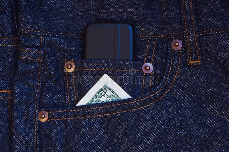 钞票美元移动电话一电话 库存照片