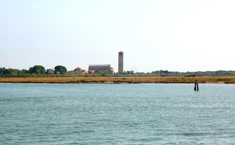 钟楼在托尔切洛岛海岛在威尼斯附近的 图库摄影