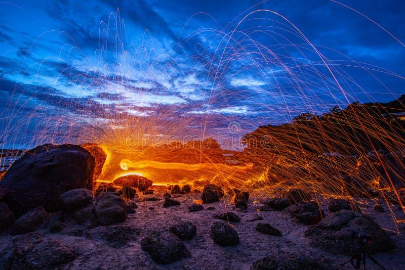 钢丝绒在岩石射击工作 免版税库存图片