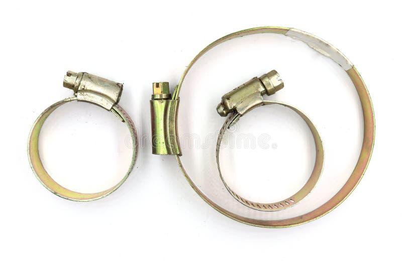 钢水管夹子,在白色背景隔绝的可调整的不锈钢穿孔的软管夹 库存照片
