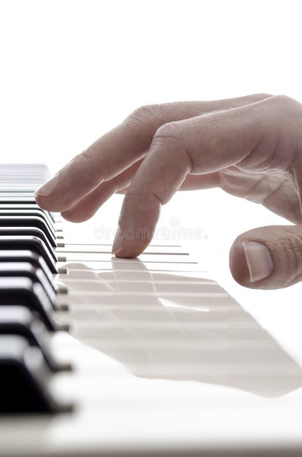 钢琴演奏家的查出的现有量 图库摄影