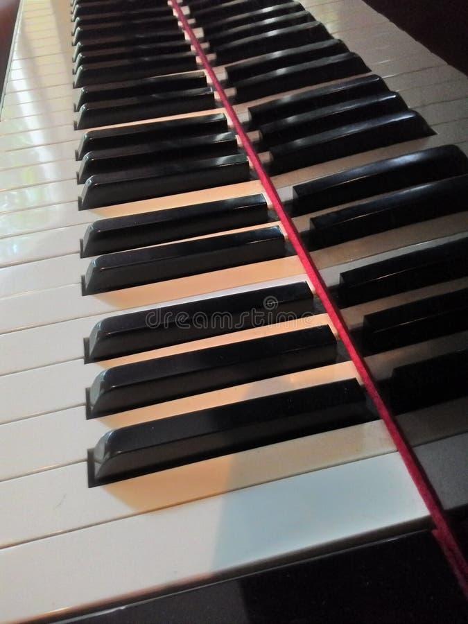 钢琴锁上阴影 库存照片