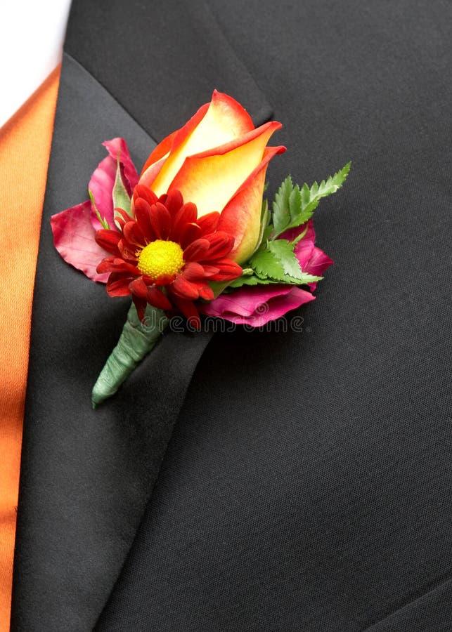 钮扣眼上插的花婚礼 库存图片