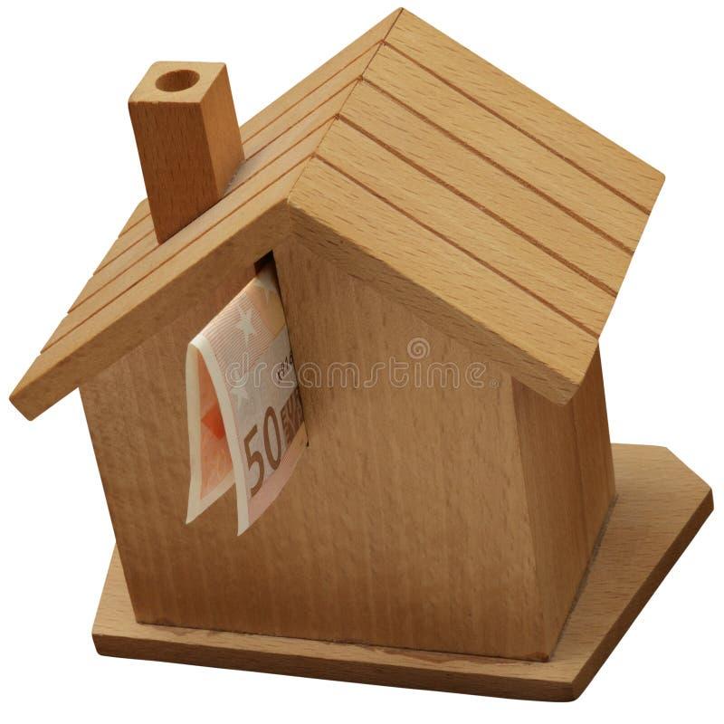 钱箱,存钱罐在一个木房子里 库存照片