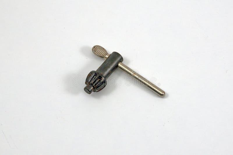 钻子在白色背景的牛颈肉钥匙 免版税图库摄影