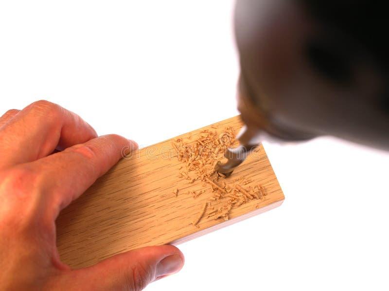 钻木头 免版税图库摄影