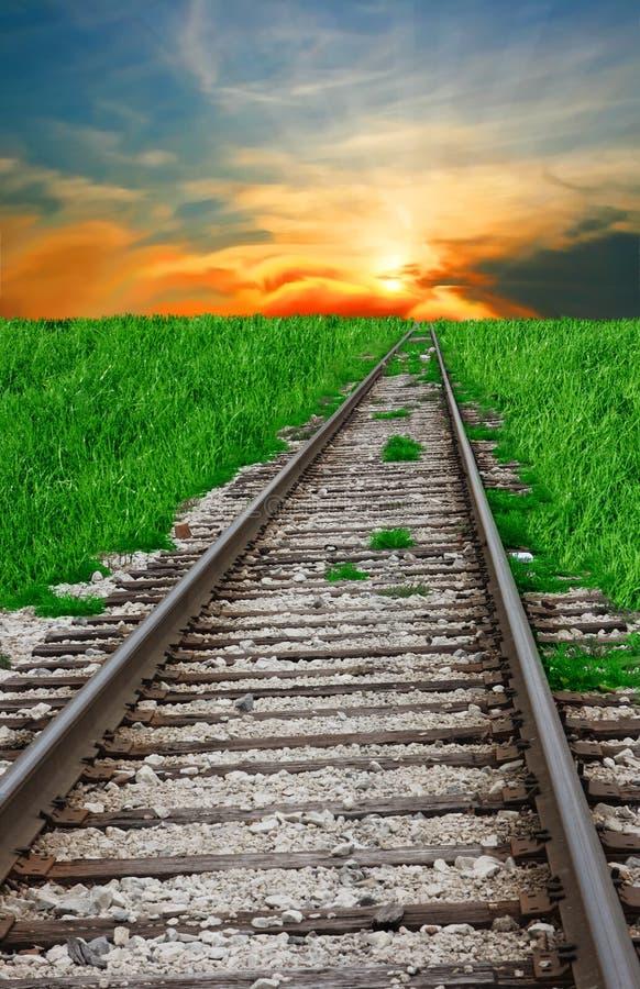 铁路和日落 库存照片