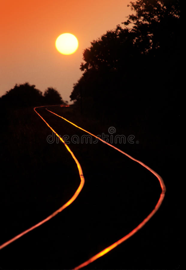 铁路日落跟踪 库存照片