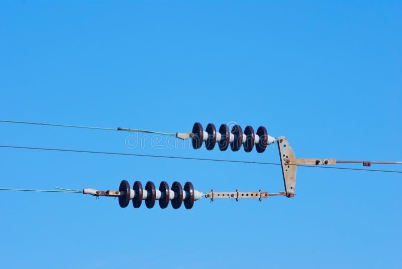 铁路蓝天的电汇杆 免版税库存照片