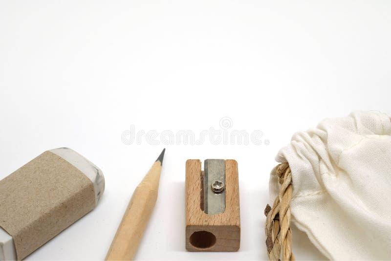 铅笔、橡皮擦、铅笔刀和织品请求 库存图片