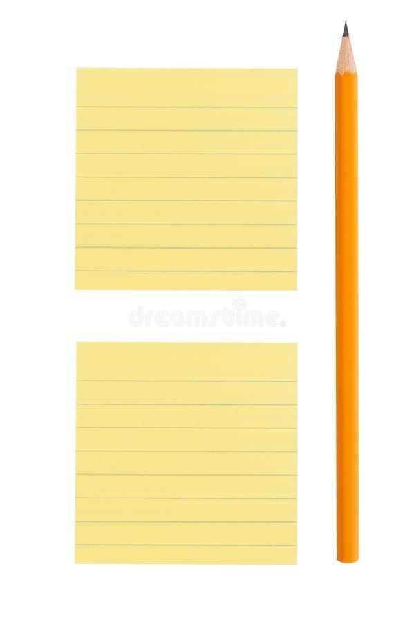 铅笔和关于空白背景的便条纸 图库摄影