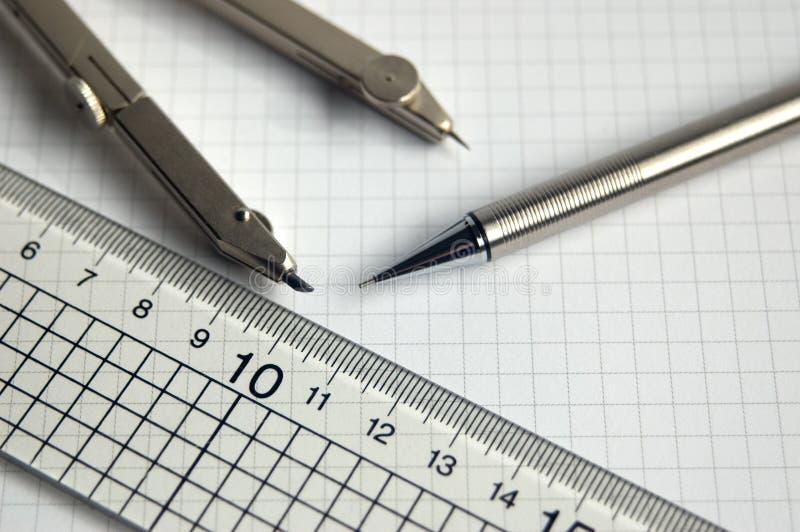 铅笔指南针和统治者 免版税库存图片