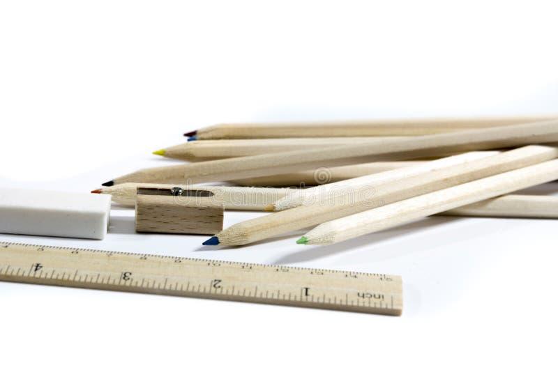 铅笔,橡皮擦,磨削器,木米统治者 库存图片