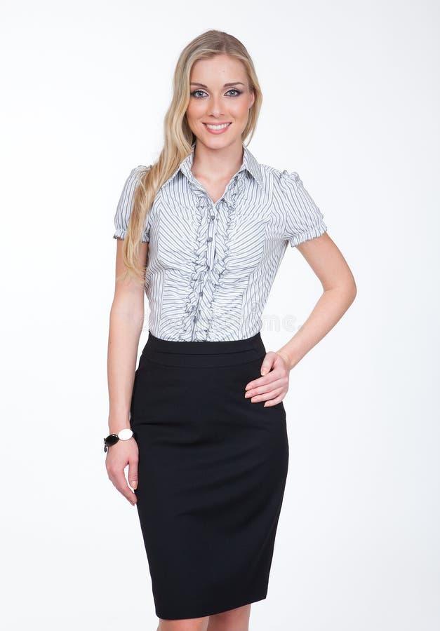年轻铅笔黑色裙子的经理白肤金发的妇女 免版税图库摄影