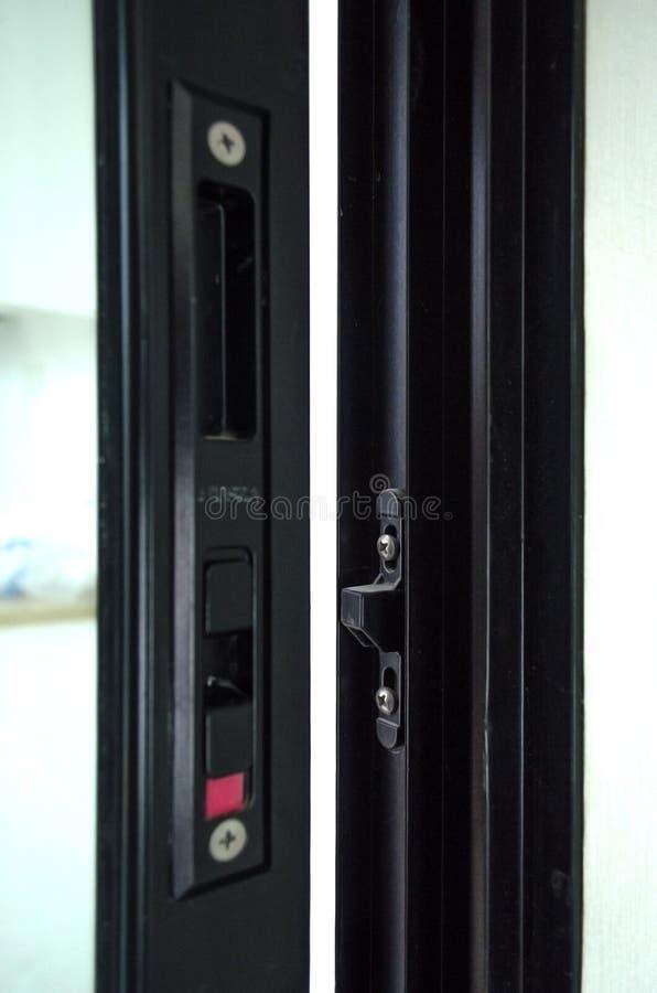 铝滚滑门锁 免版税库存照片