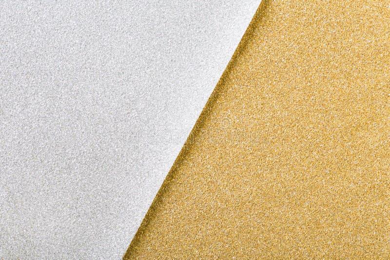 银和金子圣诞节闪烁纸背景 库存图片