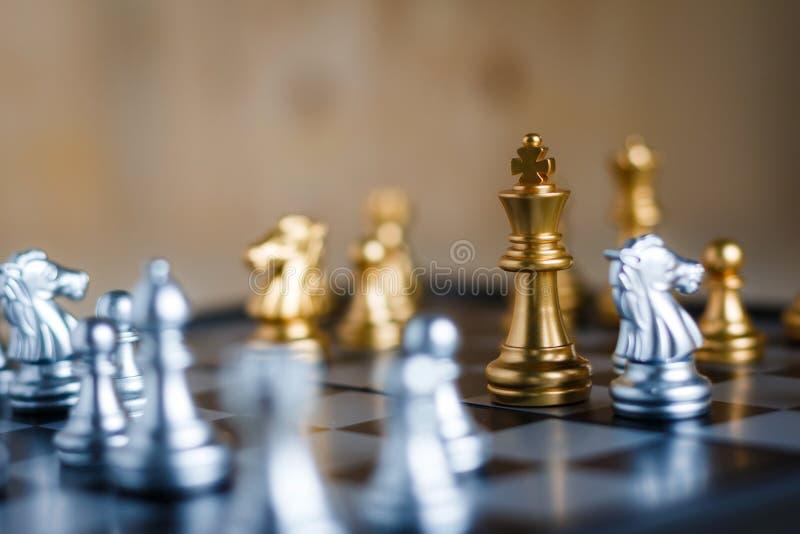 银和金黄与比赛隐喻战术和busine的敌人 图库摄影